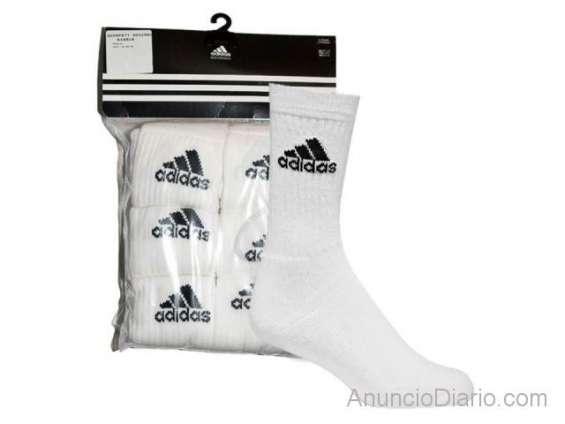 Empaca calcetines adidas en casa/$15 por paquete
